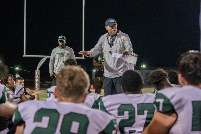 Waxahachie head football coach Shane Tolleson addresses the team following last Thursday's scrimmage at Red Oak. The Indians open the season against Rowlett at Lumpkins Stadium Friday night.