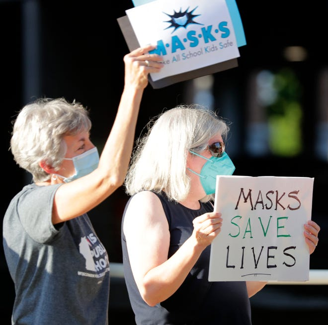 Protesters in favor of mask requirements gather at the Appleton Area School District's downtown office on Monday, Aug. 23 in Appleton. Ultimately, the Appleton School Board agreed with administrators' recommendation to require masks inside classrooms and school buildings.