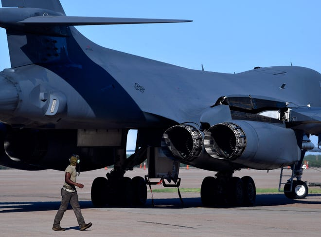 An airman watches as a B-1 bomber is turned and then backed into position during Global Strike Challenge 2021 on Tuesday at Dyess Air Force Base.