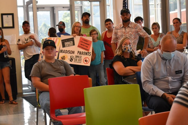 More than 50 local residents gathered at the Madison County Schools Central Office in Marshall during the Madison County Board of Education's meeting Aug. 23.