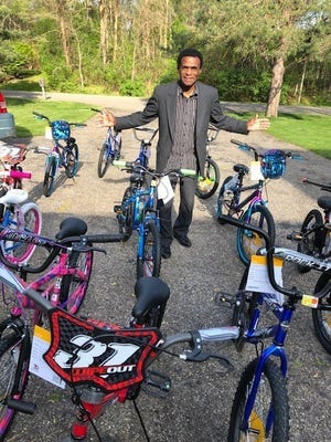 Bobby Holley giving more bicycles on Saturday.