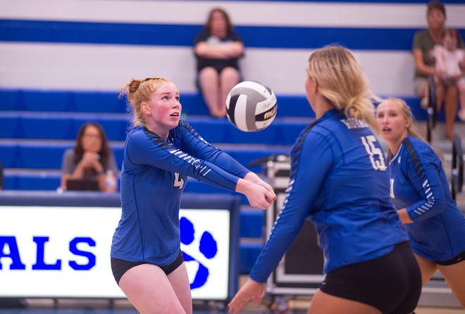 Wynford's Madalyn Johnson sets Aleece Filliater at the net.