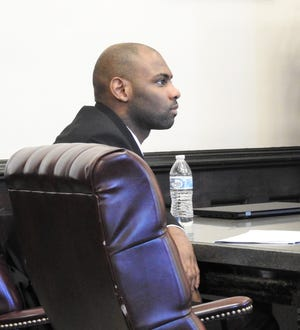 K'Marr Cooper listens to his attorney speak during opening statements Tuesday in Coshocton County Common Pleas Court for a jury trial. Cooper is accused of assault and kidnapping.