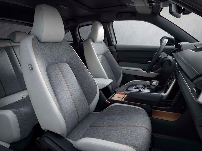 The modern interior of the 2022 Mazda MX-30 EV.