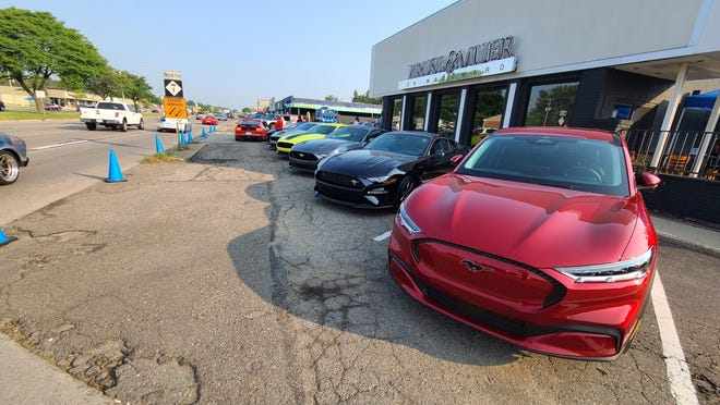 The 2021 Mustang Mach 1 has inspired the electric Mach E (foreground). They appeared together at Ford's Dream Cruise display in Royal Oak.