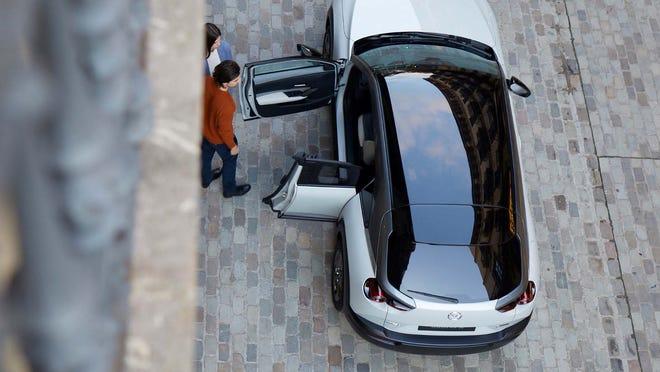 The 2022 Mazda MX-30 EV doors open like a cabinet.