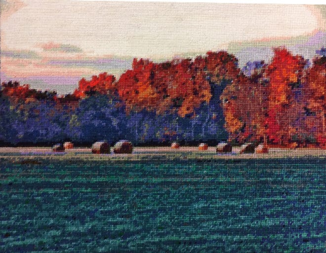 Further Down the Road, one of Beverly Koivunen's needlework projects, was based on a photo taken at a farm near her house in Green Oak Township.
