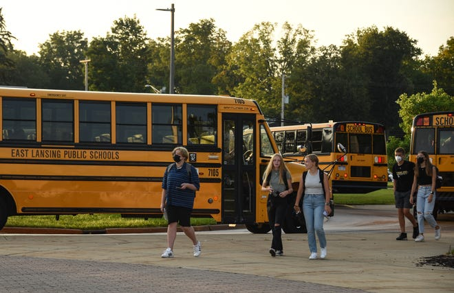 Students head into East Lansing High School Tuesday morning, Aug. 24, 2021, for the first day of school.