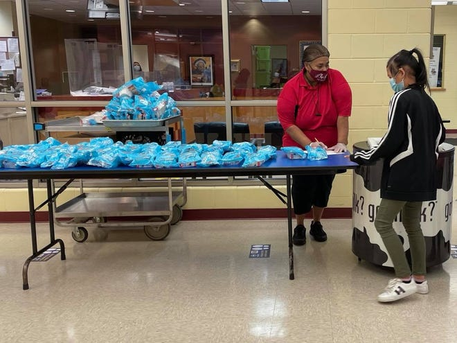 Students pick up cereal breakfast before school at Bethune Academy in Milwaukee, where meals are free for all students. The School District of Waukesha opted to end a federally funded program this fall that would continue providing free meals for all students.