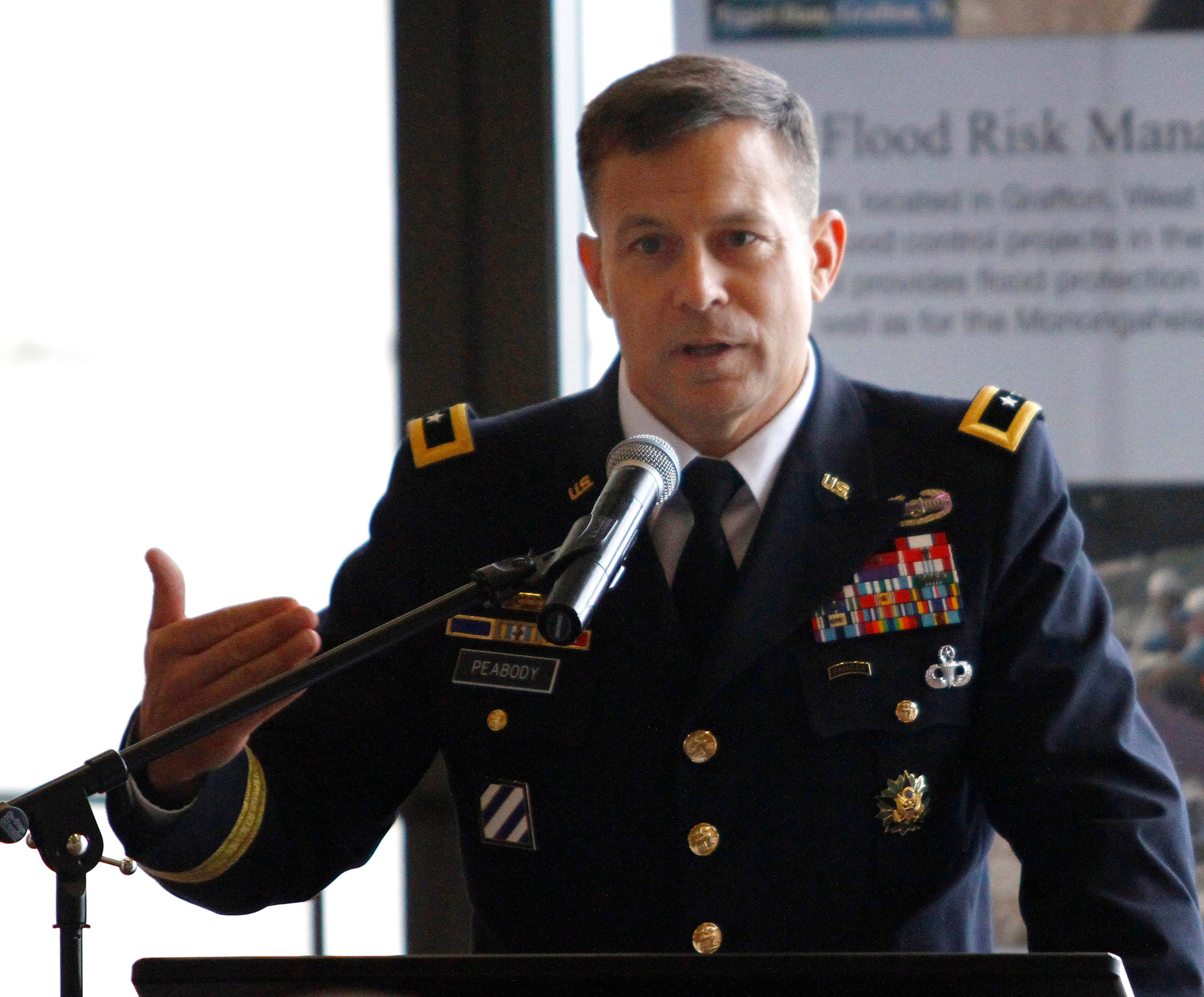 Former commander Maj. Gen. John W. Peabody makes a speech about his tenure during the change of command ceremony of the United States Army Corps of Engineers Great Lakes and Ohio River Division at the National Underground Railroad Freedom Center Museum in downtown Cincinnati, on Monday, Sept. 19, 2011.