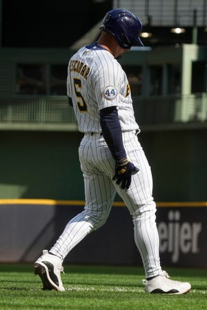 Eduardo Escobar holds his leg after running to first during the sixth inning Sunday in a game against the Nationals Sunday. Escobar was batting .280 with a .337 on-base percentage, two home runs and eight RBI in 21 games since joining the Brewers.
