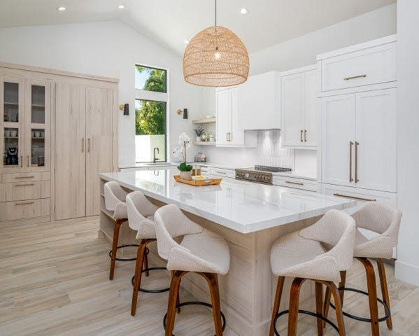 The transitional-inspired makeover of this kitchen transformed a tired, less functional very dark space into a dream kitchen.