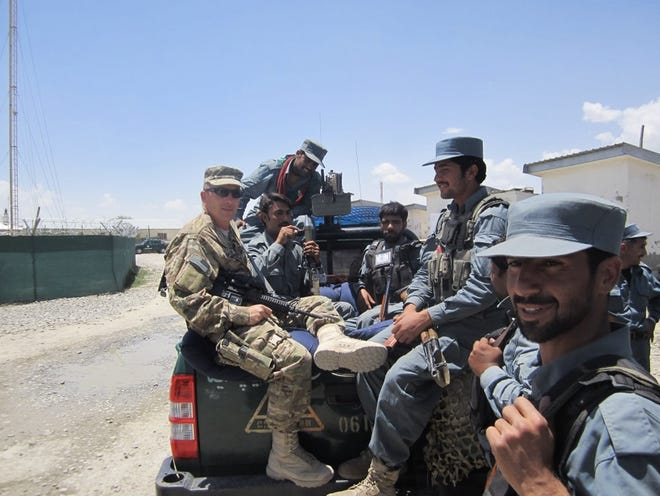 Granville Police Chief William Caskey is seen here with Afghan police.