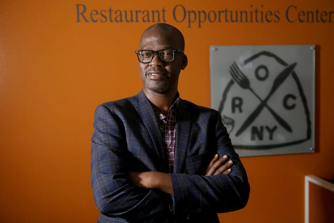 Sekou Siby, Executive Director of Restaurant Opportunities Center (ROC) United, poses for a photograph at their office in Manhattan. Siby, who used to work at Windows on the World, said after the tragedy of 9/11 they created hope with ROC.