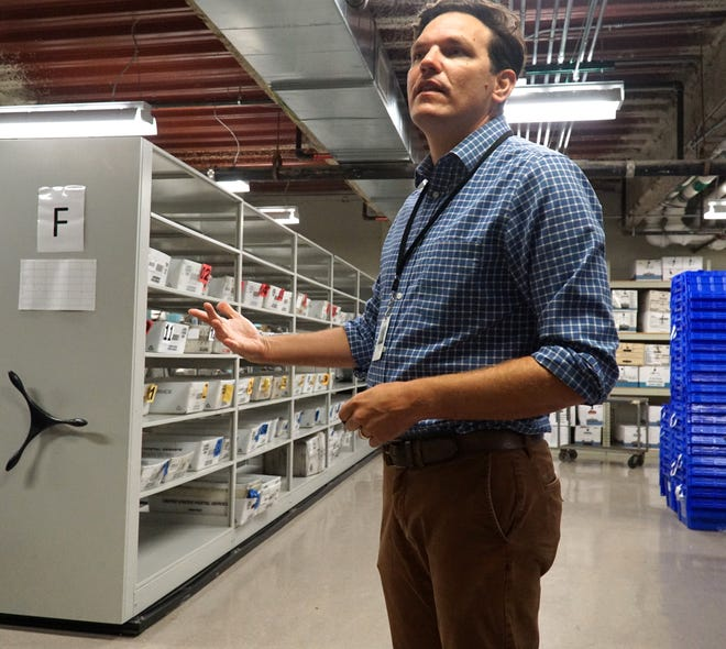 Canton Clerk Michael Siegrist in the Canton Municpal Building's secured election storage room. Shelves to the left are used to process mail-in ballots which are becoming a more popular way to cast votes. Siegrist was named Michigan Township Clerk of the Year for 2021.
