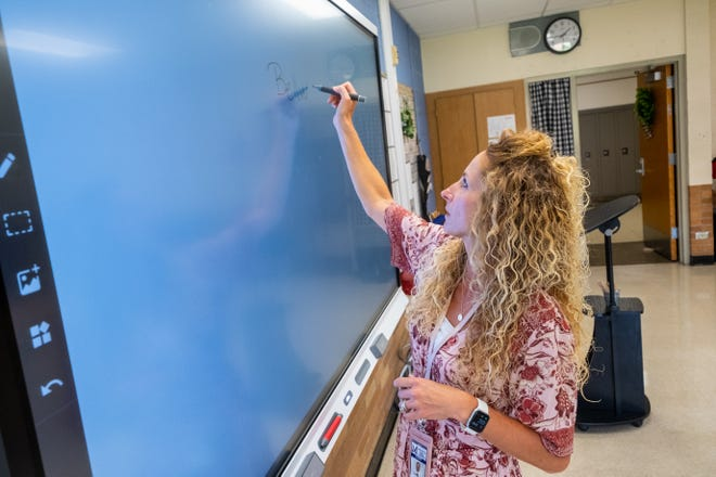 Keri Stevens, a teacher at Marysville Middle School, demonstrates how the smart board in her room works Monday, Aug. 23, 2021, in Marysville. Stevens has been a substitute teacher for the district for several years, but this is her first year as a full-time teacher.