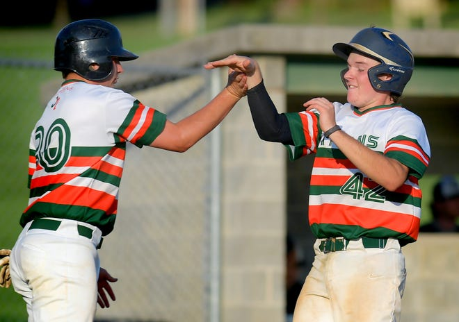 Jefferson's Dylan Shaffer and Emidio Bucci congratulate each other after scoring runs in a game earlier this season. The Titans will attempt to win a third consecutive Tom Kerrigan Memorial Baseball Tournament championship this weekend.