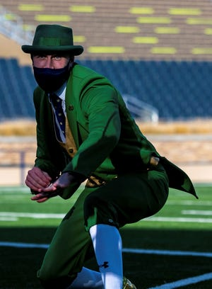 Notre Dame leprechaun Conal Fagan performs during a live broadcast of ESPN College Gameday at Notre Dame Stadium before the game between the Notre Dame Fighting Irish and the Clemson Tigers, Saturday, Nov. 7, 2020, in South Bend, Ind. (Matt Cashore/Pool Photo via AP)
