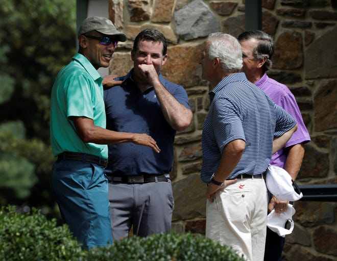 President Barack Obama speaks to Under Armour CEO and Chairman Kevin Plank, second from left, and two others before playing a round of golf at Caves Valley Golf Club in Owings Mills, Maryland, in 2016. Caves Valley will play host to the PGA Tour's BMW Championship this week. (AP Photo/Manuel Balce Ceneta)