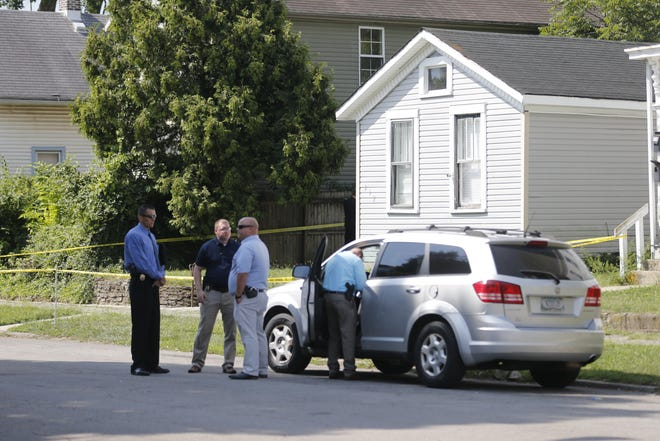 Richmond Police Department investigators waited for a search warrant Tuesday, Aug. 24, 2021, in the 600 block of South Seventh Street.