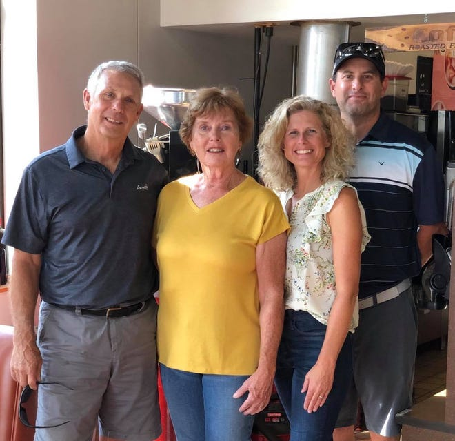 Jack and Doris Sitzmann pose with Emily and Ryan Vincelli (left to right) for a photo. The group of two couples are soon-to-be former owners of Dunn Brothers Coffee in eastern Sioux Falls.