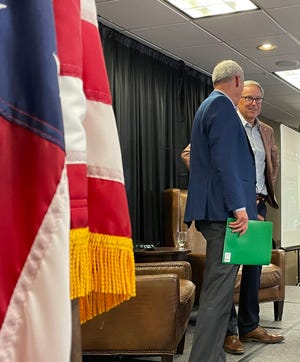 Raven CEO and president Dan Rykhus (right) stands after speaking about the company's buyout. Rotary Club at the Holiday Inn, Sioux Falls. August 23, 2021.