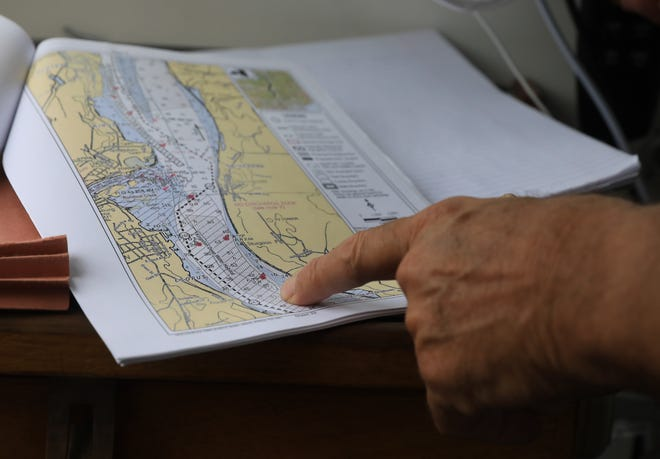 John Lipscomb pilot of the Riverkeeper's patrol boat, points to locations on a river chart as he heads down the Hudson River on Monday, August 23, 2021.