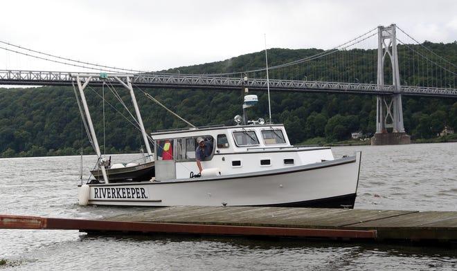 John Lipscomb pilots Riverkeeper's patrol boat, R. Ian Fletcher, along the Hudson River on Monday, August 23, 2021.