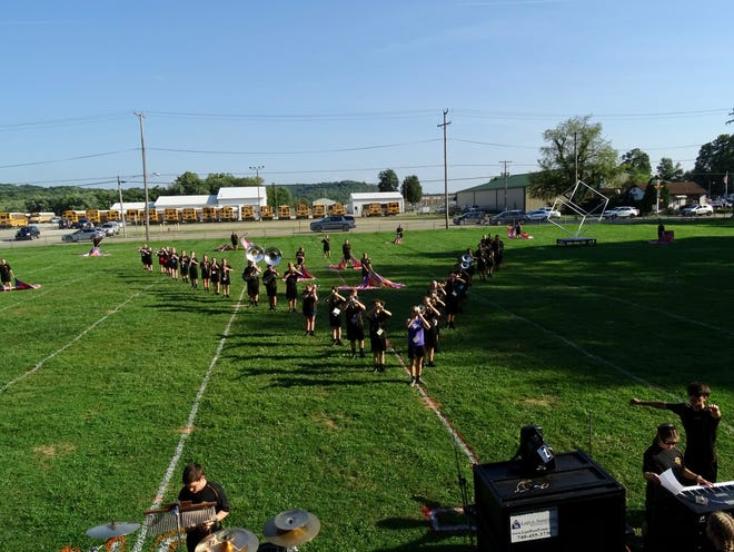 """The Tri-Valley Marching Band rehearses on Monday, Aug. 23, 2021. The title of this year's show is """"Unboxed,"""" with the show starting in more angular, structured marching patterns and eventually breaking loose into more free shapes."""