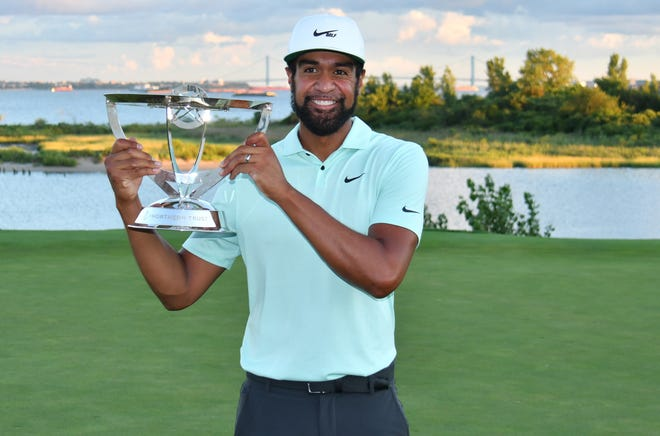 Aug. 23: Tony Finau holds the winners trophy after winning The Northern Trust at the Liberty National Golf Club in Jersey City, N.J.