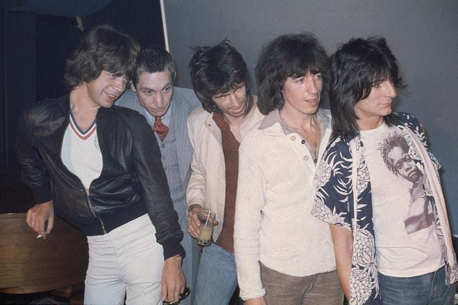 Rolling Stones at the Trax Club in New York City, NY, September 23, 1977, to promote their new album.  Left to right;  Mick Jagger, Charlie Watts, Keith Richards, Bill Wyman and Ron Wood.