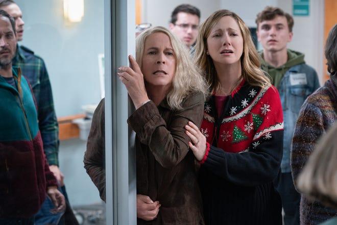 Larry Strode (Jamie Lee Curtis, left) and daughter Karen (Judy Greer) reel in Michael Myers