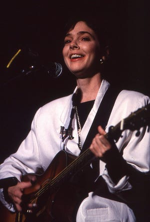 Nanci Griffith performs at the Austin Music Awards at Palmer Auditorium in 1990.