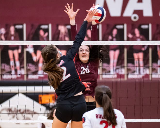 Molly Cravens goes up for a block for Round Rock against Bowie's Maya Arrambide in a three-set win over Bowie Tuesday at Round Rock High School.