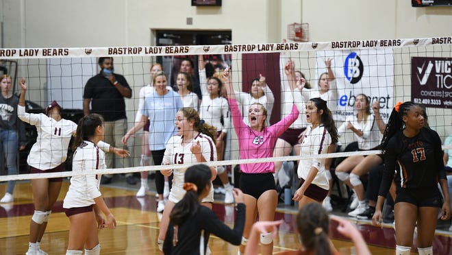 Bastrop players celebrate a point during a tournament victory over Hutto on Saturday.