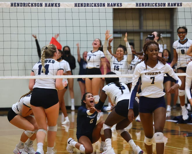 Hendrickson libero Isabelle Martinez, 6, and her Hawks teammates celebrate a second-set comeback against Stony Point in nondistrict action Aug. 24 at Hendrickson High School. The host Hawks defeated the visiting Tigers 3-0.