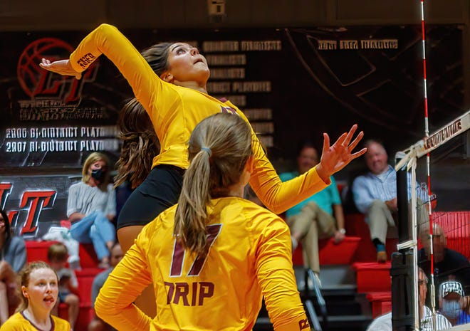 Dripping Springs outside hitter Mackenzie Plante, setting up for a kill against Lake Travis earlier this month, will continue her volleyball career after graduation when she suits up for the University of Tennessee.