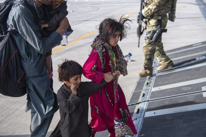 In this image provided by the U.S. Air Force, people board a U.S. Air Force C-17 Globemaster III at Hamid Karzai International Airport in Kabul, Afghanistan, Tuesday. [MASTER SGT. DONALD R. ALLEN/U.S. AIR FORCE via AP]