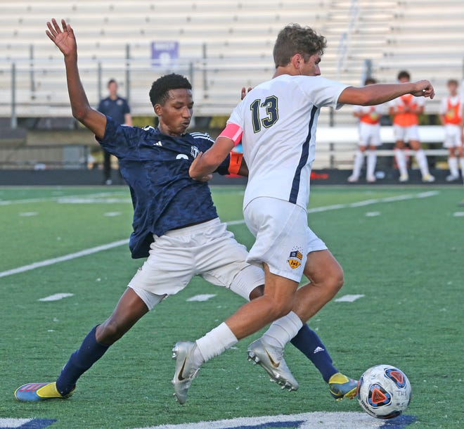 In a game earlier this season, Twinsburg's Uleto Fuentes steals the ball in from of St. Ignatius' Josip Rimac. Fuentes had a hat trick in a 3-0 win over Willoughby South.