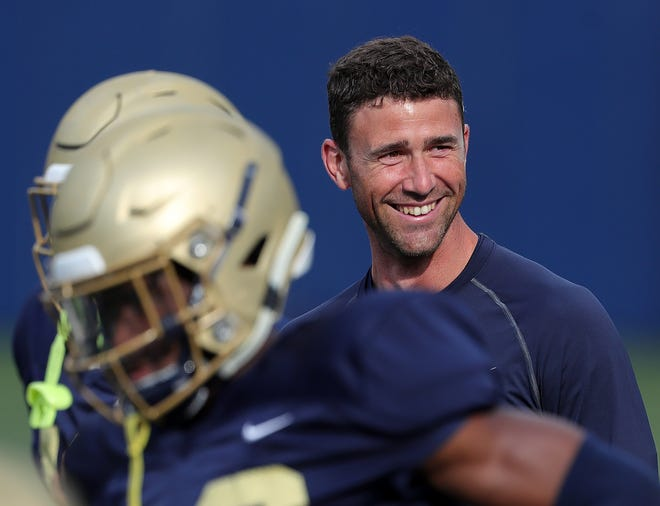 University of Akron football coach Tom Arth greets everyone with a smile. That doesn't mean he isn't all business when it comes to his football team and the challenges he faces trying to turn around a program that has won just one game the past two seasons. [Jeff Lange/Beacon Journal]