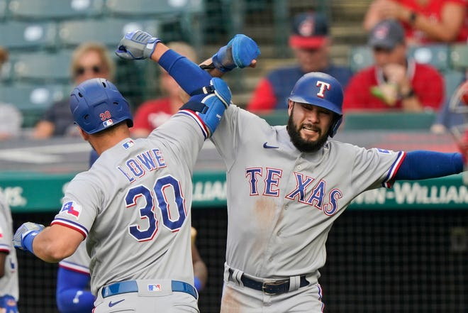 Texas Rangers' Isiah Kiner-Falefa, right, congratulates Nathaniel Lowe after Lowe hit a three-run home run in the first inning of a 7-3 win over Cleveland on Tuesday night. [Tony Dejak/Associated Press]