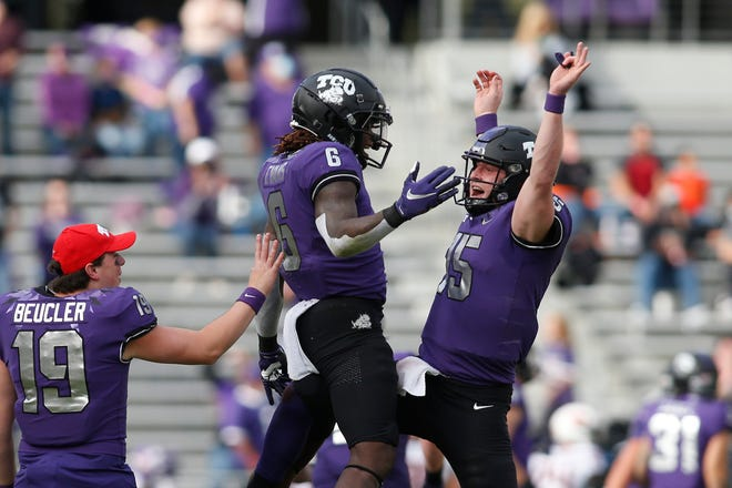 TCU quarterback Max Duggan, right, celebrates a touchdown with running back Zach Evans during last season's game against Oklahoma State. The Horned Frogs return both players for 2021.