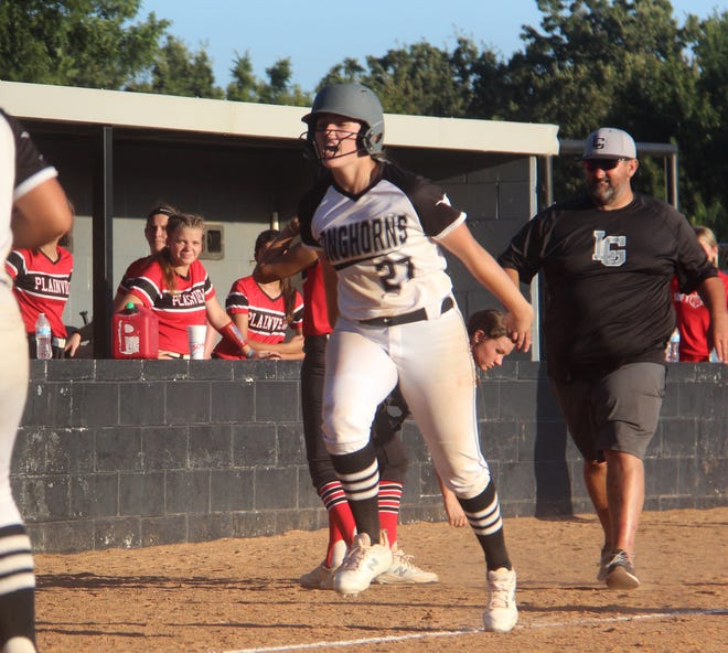 Lady Horns sophomore Lilly Hacker celebrates as she runs to home plate after hitting a walk-off home run Tuesday in a 3-2 victory over Plainview.