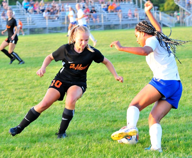 Ashland High School's Taylor Garver eyes the ball as Ontario High School's Kyla Spencer takes it up the field during a soccer game at Community Soccer Stadium Tuesday, Aug. 24, 2021.