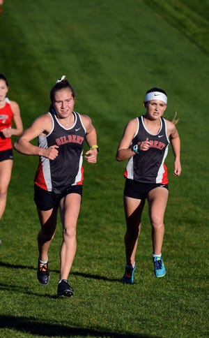 Junior Abby McGuire (left) and senior Sophie Vanderpool will lead the Gilbert girls' cross country team into the 2021 season. Both runners were all-Raccoon River Conference runners and Vanderpool qualified for state in 2020.