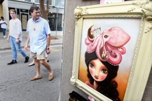 A painting by Marisol Spoon awaits visitors strolling along Broad Street during the 2018 Arts in the Heart of Augusta Festival. The annual event is being scaled down for 2021 and rebranded as the ArtsCity Festival.