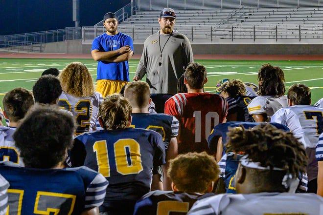 Battle coach Jonah Dubinski talks to his team after preseason practice.