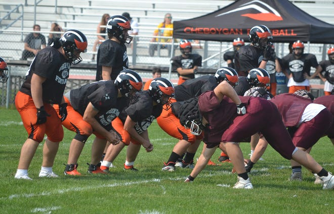 Cheboygan offensive players get ready for an upcoming play against Charlevoix during a scrimmage from last week. Cheboygan will open up its regular season with a 7 p.m. home clash with Petoskey on Friday night.