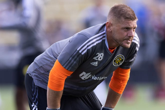 Jun 19, 2021; Columbus Crew goalkeeper Matt Lampson (28) warms up prior to the match against against Chicago Fire for the final game at Historic Crew Stadium. Mandatory Credit: Greg Bartram-USA TODAY Sports