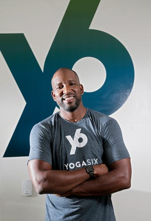 Former OSU basketball star Michael Redd is now the co-owner of YogaSix, in Upper Arlington.